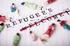 Refugees welcome strikethrough text on paper Royalty Free Stock Photos