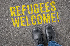 Refugees welcome. Text on the floor - Refugees welcome Stock Images