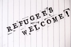Refugees welcome text on paper. Refugees welcome text on white line paper Royalty Free Stock Photo