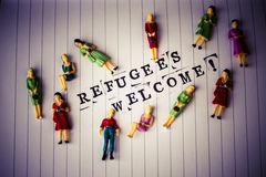 Refugees welcome text on paper Royalty Free Stock Images