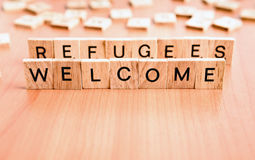 Refugees Welcome. Text on wooden tiles letters royalty free stock images