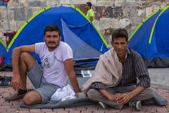 Refugiados que chegam em Grécia por barcos infláveis de Turquia Fotos de Stock