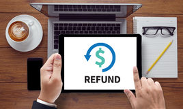 REFUND and Tax Refund Fine Duty Taxation. On the tablet pc screen held by businessman hands - online, top view stock photo