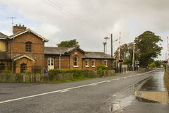 The refurbished station and automatic rail crossing at the townland of Bellerena in County Londonderry, Ireland Stock Images