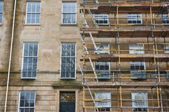 Refurbishment works to a traditional sandstone building in Glasgow. An ongoing refurbishment works to a traditional sandstone building typical to Glasgow Stock Image