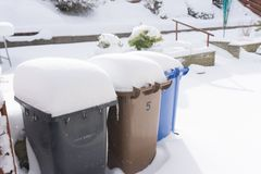 Refuse bins Covered in Snow. Stock Images