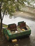 Refuse collection body. Refuse collection container in rainy fall Royalty Free Stock Image