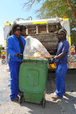 Refuse removal workers. Men collecting rubbish in tipper truck. Ndlambe Municipality, Eastern Cape, Port Alfred, South aFrica Stock Image