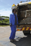 Refuse removal workers. Men collecting rubbish in tipper truck. Ndlambe Municipality, Eastern Cape, Port Alfred, South aFrica Royalty Free Stock Photography