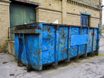 Refuse Skip in front of Brick Building Royalty Free Stock Photo
