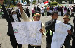 Refuse terrorism. A number of student doing anti terrorism demonstration in Solo, Monday (27/9 Stock Images