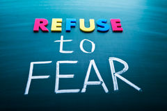 Refuse to fear. Colorful conceptual words on blackboard royalty free stock photos