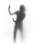 Refuse, woman silhouette. Silhouette of a woman behind a textile Stock Image