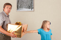 Refused gift, shocked father Stock Photo