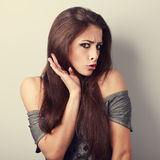 Refused grumpy young brunette woman with hand hear face and surp Royalty Free Stock Photo