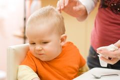 Refusing to be wiped. Little baby boy refusing to be wiped after lunch Royalty Free Stock Photography
