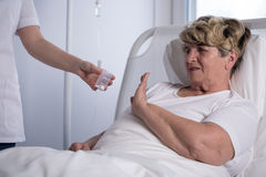 Refusing to take medicine Stock Image