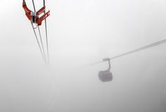 Reg gondola lift inside big cloud Royalty Free Stock Photos