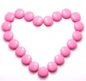 Reg heart. Pills in shape of love heart on white background Stock Photos