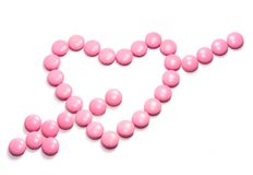 Reg heart. Pills in shape of love heart on white background Royalty Free Stock Photography