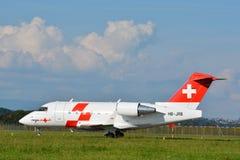 Rega - Schweizer Sanitätsflugzeug-Fläche HB-JRB Stockbild