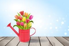 Regadera con el ramo de tulipanes Foto de archivo