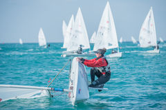 Regaining the balance. Trying to turn back the boat in sailing competition The Laser EUROPA CUP 2016 Royalty Free Stock Photo