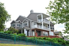 Regal Hilltop Modern Victorian Style Mansion. Royalty Free Stock Photography