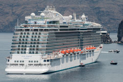 Regal Princess cruise ship. Anchored in Santorini, Greece. Princess Cruise Lines Stock Photos