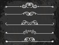 Regal rule line with crowns. On grunge background Royalty Free Stock Photo
