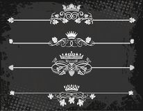 Regal rule line with crowns. On grunge background Stock Photos