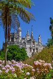 Regaleira Palace seen through the Gardens. Sintra, Portugal - July, 2015: Regaleira Palace seen through the Gardens. A neo-manueline palace decorated with Stock Image