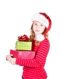 Regali di Natale d'uso teenager della tenuta del cappello di Santa Fotografia Stock Libera da Diritti