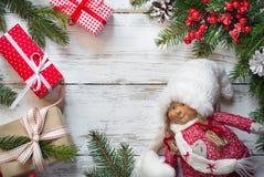 Regali di Natale e bambola di Natale Fotografia Stock