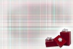 Regali di Natale su un fondo del plaid di Natale fotografie stock