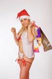 Regali molto sexy della holding della ragazza della sig.ra il Babbo Natale Fotografie Stock