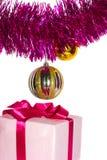 Regalo con oropel y juguetes Imagen de archivo libre de regalías