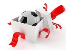 Regalo con pallone da calcio Immagini Stock Libere da Diritti