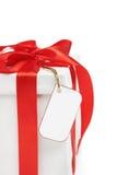 Regalo de la Navidad blanca con la etiqueta en blanco foto de archivo libre de regalías