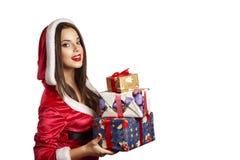 Regalo de la Navidad del asimiento del retrato de la mujer del sombrero de Santa de la Navidad Imagenes de archivo