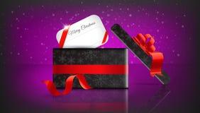 Regalo de la Navidad en fondo rojo con nieve y copos de nieve feliz Fotografía de archivo libre de regalías