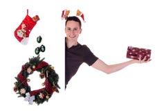 Regalo de Navidad del hombre Foto de archivo libre de regalías