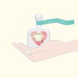 Regalo de un corazón que simboliza amor puro Foto de archivo libre de regalías