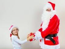 Regalo del givig del Babbo Natale per la ragazza Immagine Stock Libera da Diritti