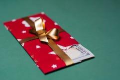 Regalo di Natale del denaro contante di U S valuta Immagini Stock Libere da Diritti