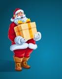 Regalo di Santa Claus di Natale grande in mani Fotografie Stock
