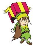 Regalo que lleva de la muchacha del duende de la Navidad Fotos de archivo