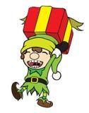 Regalo que lleva del muchacho del duende de la Navidad Fotografía de archivo