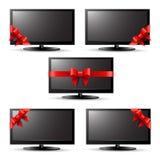 Regalo TV con un nastro rosso Immagini Stock Libere da Diritti