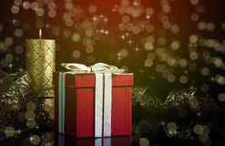 Regalo y vela de la Navidad Fotografía de archivo libre de regalías